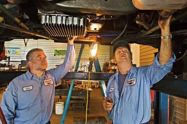 Motorhome Wall Art - Photograph - Mechanics Repairing Recreational Vehicle by Jim West