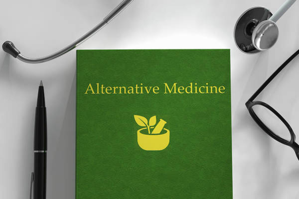 Complementary Colours Photograph - Medical Book About Alternative Medicine by Ikon Images