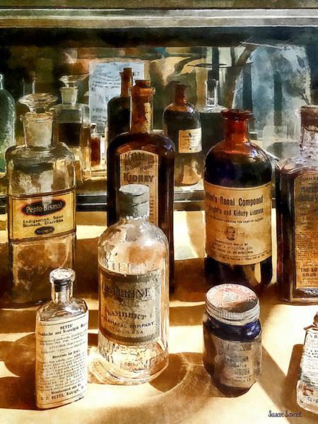 Photograph - Medicine Bottles In Glass Case by Susan Savad