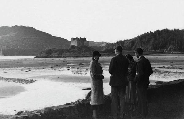 Landmark Photograph - Men And Women Standing On A Bank Of A Lake by John Mcmullin