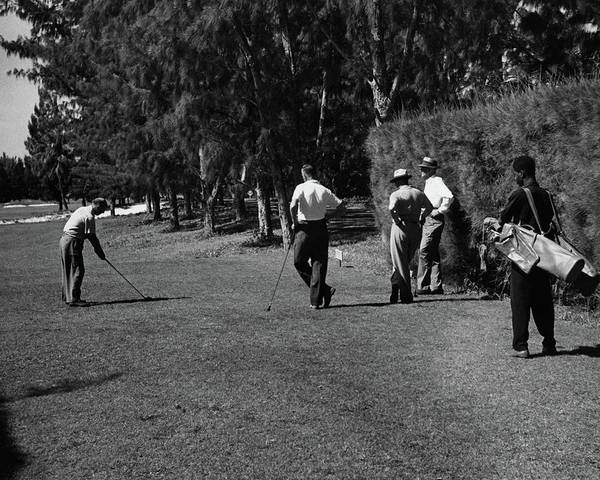 Golf Club Photograph - Men Playing Golf At The Jupiter Island Club by Serge Balkin