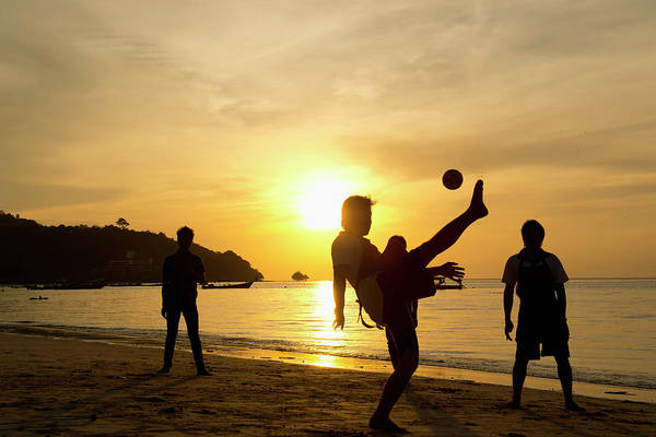 Adult Male Photograph - Men Playing Takraw Ball At Sunset On by Stuart Corlett / Design Pics