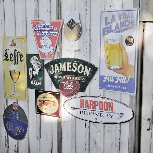 Photograph - Metal Beer Signs On Wood by Bradford Martin