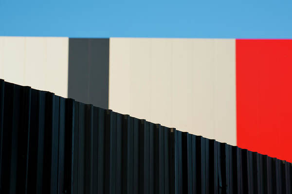 Photograph - Metallic Fence Against Modern Colorful by Paolo Carnassale