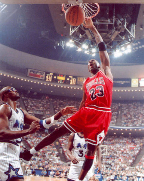 Wall Art - Photograph - Michael Jordan Dunks With Left Hand by Retro Images Archive