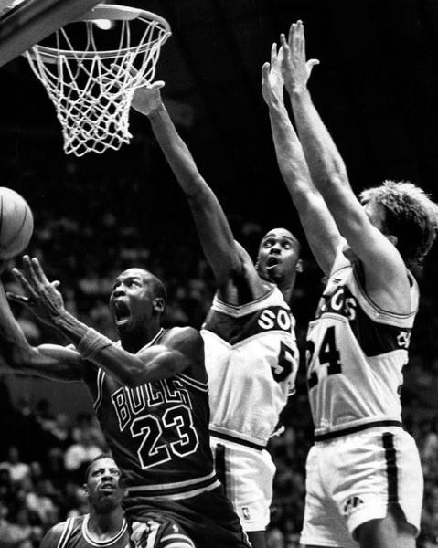 Chicago Bulls Photograph - Michael Jordan Going For A Hard Layup by Retro Images Archive