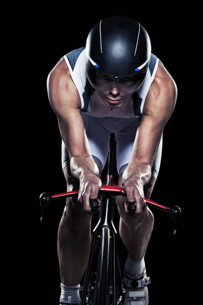 Helmet Photograph - Mid Adult Woman Cycling, Studio Shot by Johner Images