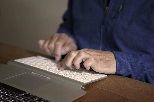 Midsection Of Man Typing On Keyboard At Table Art Print by Paulien Tabak / EyeEm