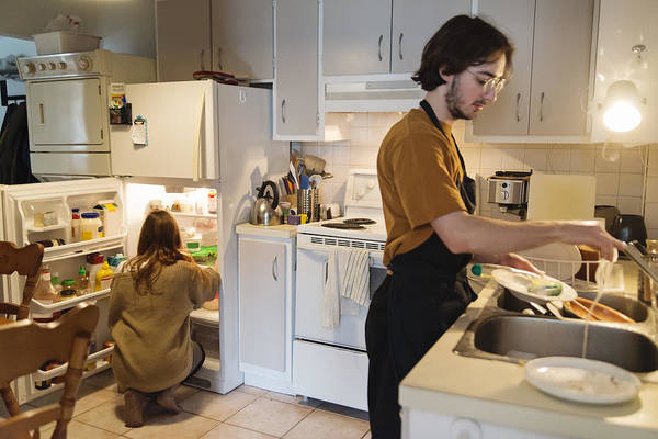 Millennial Couple Of Students Shared Living Doing Chores. Art Print by Martinedoucet