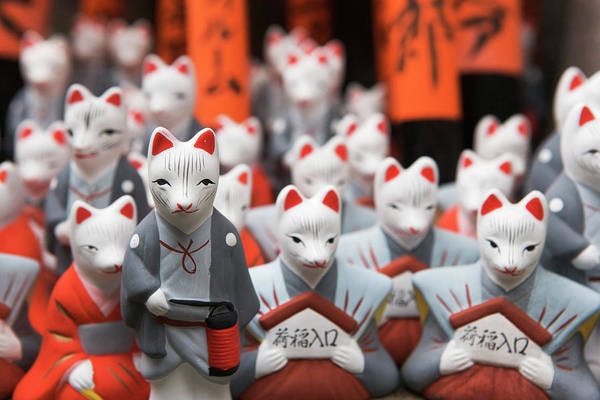 Wall Art - Photograph - Miniature Fox Statues At The Fushimi by Ron Koeberer