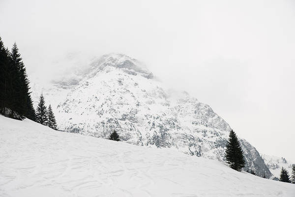 Photograph - Minimalist Snow Landscape - Mountain And Trees In Winter by Matthias Hauser