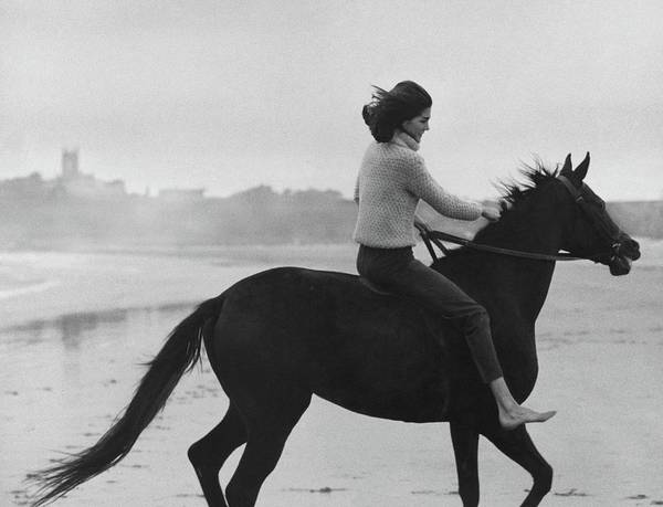 Outdoor Photograph - Minnie Cushing Riding A Horse by Toni Frissell