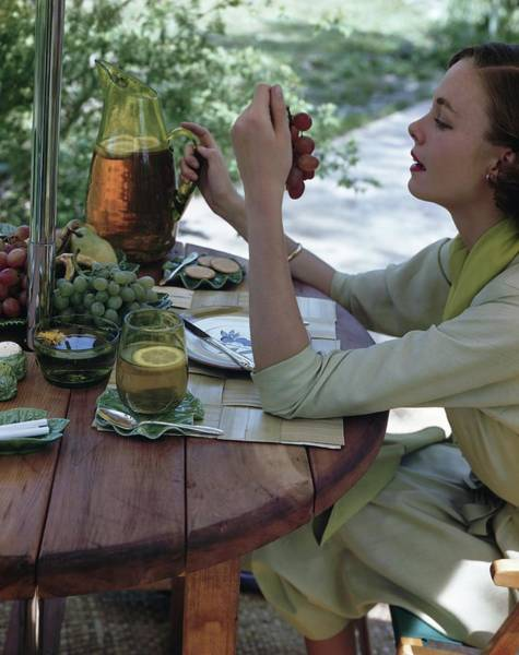 Pitcher Photograph - Model At An Outdoor Table by Horst P. Horst