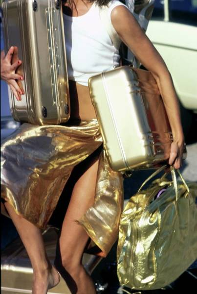 Luggage Photograph - Model Carrying Gold Luggage by Arthur Elgort