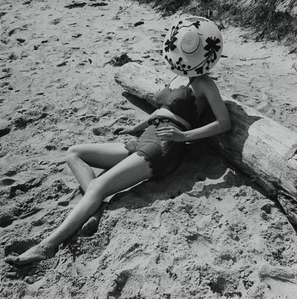 Wall Art - Photograph - Model Covering Her Face With Hat On Beach by Toni Frissell