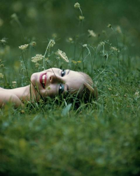 Countryside Photograph - Model Gretchen Harris Lying In A Field by Karen Radkai