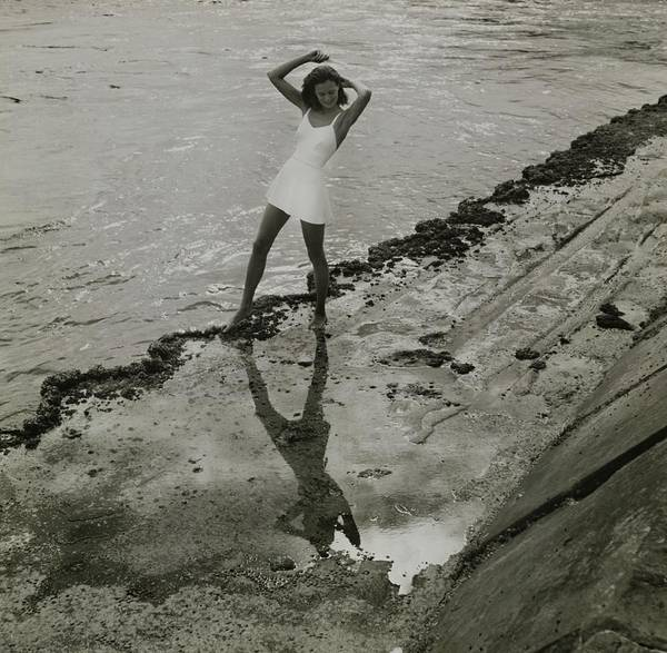Swimsuit Photograph - Model In One Piece Swimsuit On Beach by Toni Frissell