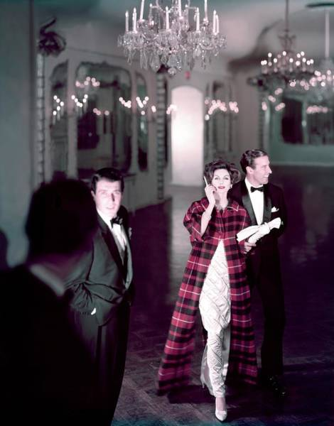Architecture Photograph - Model In Silver Dress Escorted By A Gentleman by Henry Clarke