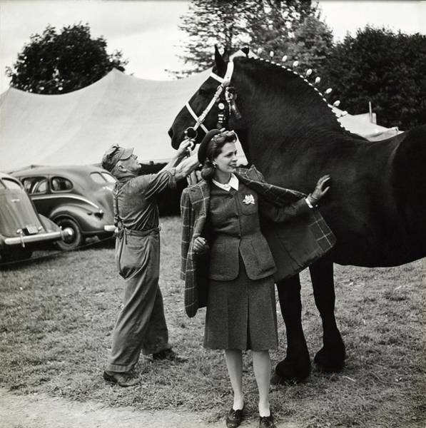 Wall Art - Photograph - Model In Tweed Suit With Horse And Trainer by Toni Frissell
