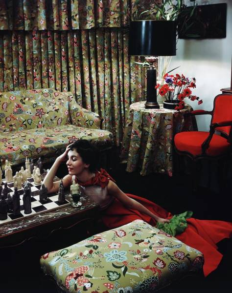 Flower Head Photograph - Model Leaning On A Chess Table by Horst P. Horst