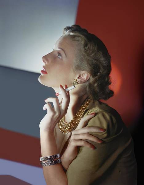 Wall Art - Photograph - Model Smoking Cigarette by Horst P. Horst