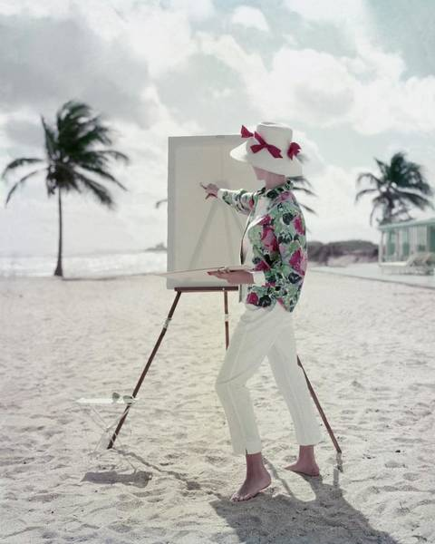 Coastline Photograph - Model Standing On A Beach In Front Of An Easel by Frances McLaughlin-Gill