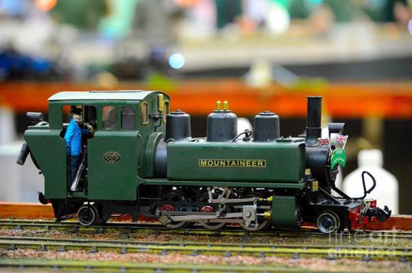 Photograph - Model Train Green Steam Engine With Driver In Cab by Imran Ahmed