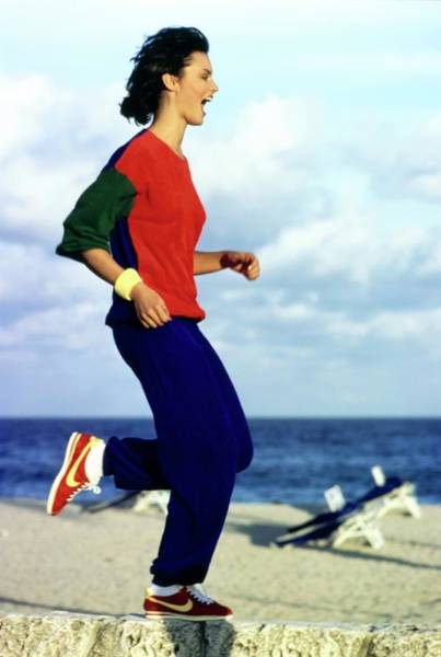 Exercise Photograph - Model Wearing A Castelbajac Jogging Suit by Arthur Elgort