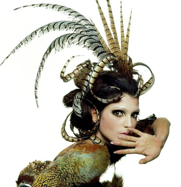 Autumn Photograph - Model Wearing A Feather Headdress by Bert Stern