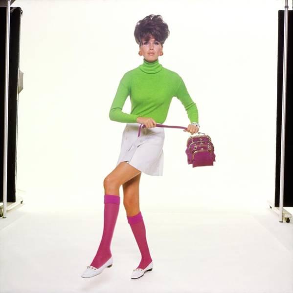 Wall Art - Photograph - Model Wearing A Green Turtleneck by Bert Stern
