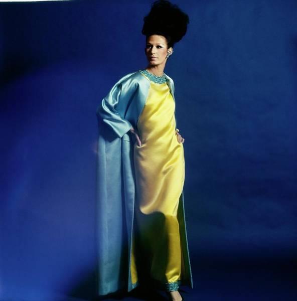 Blue Gown Photograph - Model Wearing A Harold Levine Ensemble by Bert Stern