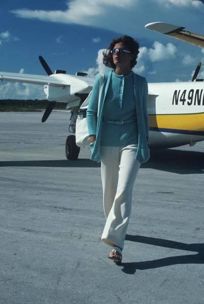 Runway Model Photograph - Model Wearing A Kimberly Ensemble On A Runway by Kourken Pakchanian