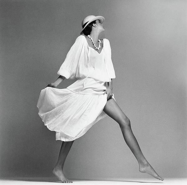 People Walking Photograph - Model Wearing A Marta Salvadori Shirt And Skirt by Francesco Scavullo