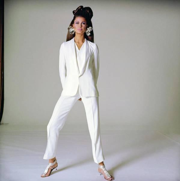 Wall Art - Photograph - Model Wearing A Micmac Pantsuit by Bert Stern
