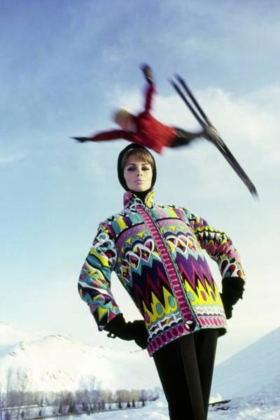 Snow Photograph - Model Wearing A Print Jacket Under A Jumping by Peter Beard