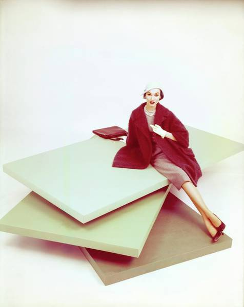 Wall Art - Photograph - Model Wearing A Red Coat by John Rawlings