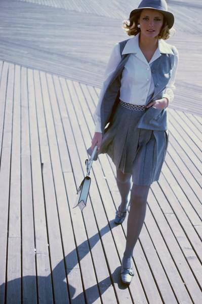 People Walking Photograph - Model Wearing A Sloat Skirt And Waistcoat by Sante Forlano