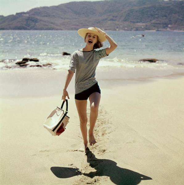 People Walking Photograph - Model Wearing A Straw Hat On A Beach by Sante Forlano