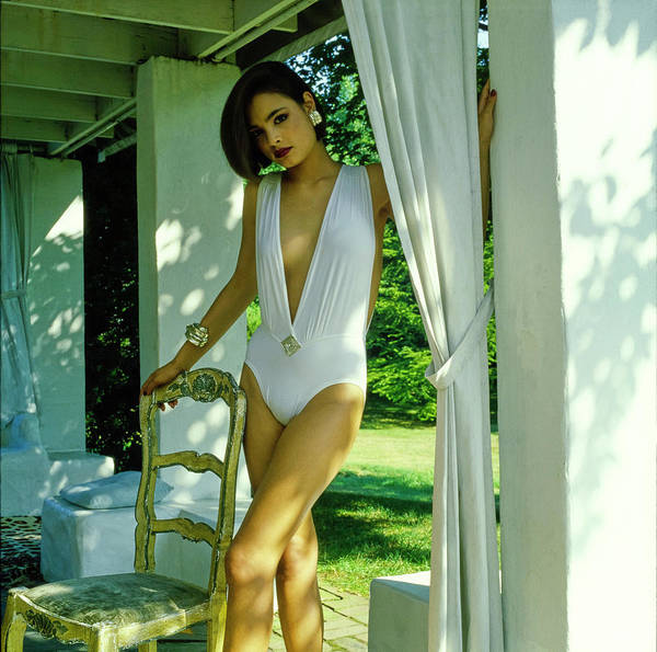 Patio Photograph - Model Wearing A White Swimsuit by Horst P. Horst