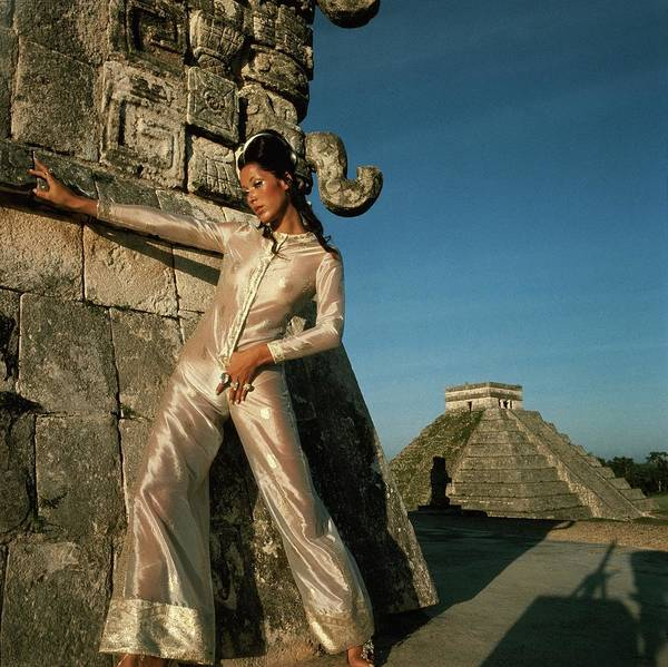 Facade Photograph - Model Wearing An Ivory And Gold Jumpsuit by Henry Clarke
