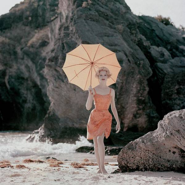 Swimsuit Photograph - Model Wearing An Orange Bathing Suit Holding by Jerry Schatzberg