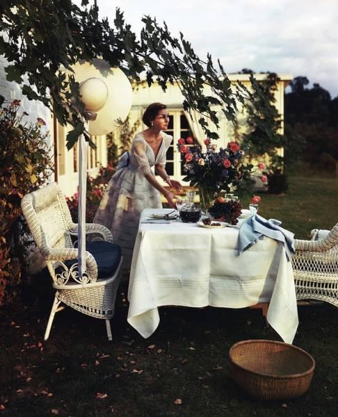 Front Yard Photograph - Model Wearing Bergdorf Goodman Dress Setting by Horst P. Horst