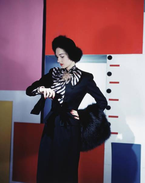 Wall Art - Photograph - Model Wearing Black Suit Checking Her Watch by Horst P. Horst