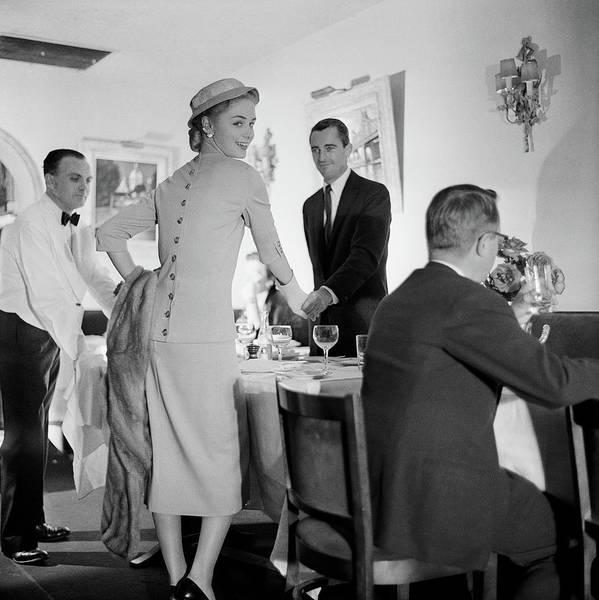 Waiter Photograph - Model Wearing Dress In Restaurant by Horst P. Horst