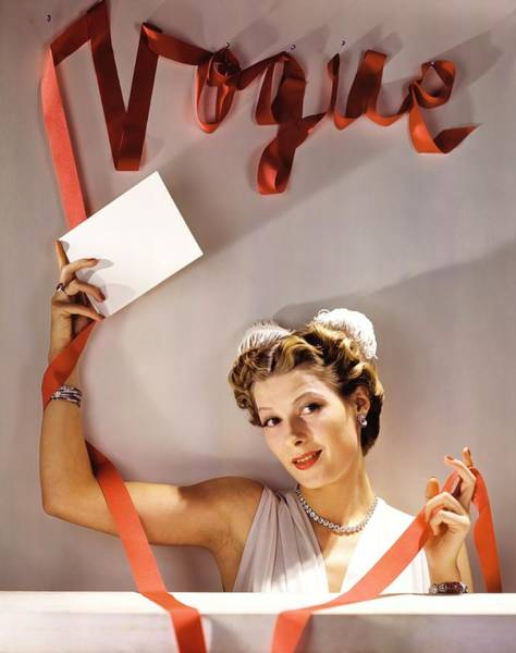 Sign Photograph - Model Wearing Jewellery Under A Vogue Sign by John Rawlings