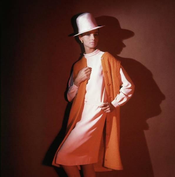 Orange Flower Photograph - Model Wearing Orange Vest And White Hat by Horst P. Horst