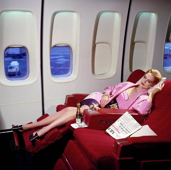 Champagne Photograph - Model Wearing Pink Jacket On Airplane by Horst P. Horst