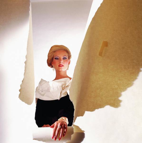 Wall Art - Photograph - Model Wearing Satin Collar Behind Ripped Paper by Horst P. Horst