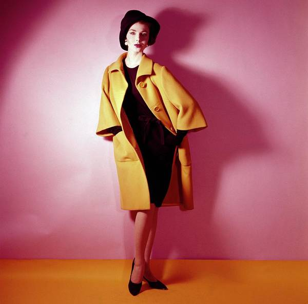 Yellow Background Photograph - Model Wearing Yellow Coat By Norman Norell by Horst P. Horst