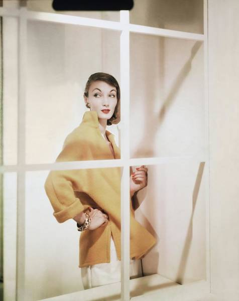 View Through Window Photograph - Model Wearing Yellow Sweater by Horst P. Horst